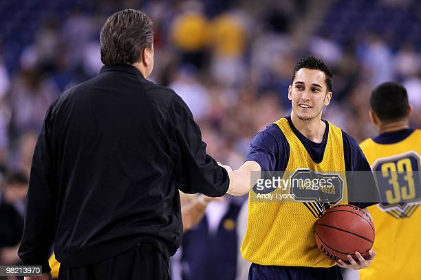 Head coach Bob Huggins of the West Virginia Mountaineers shakes hands with Jonnie West during practice prior to the 2010 Final Four of the NCAA...