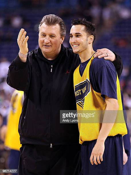 Head coach Bob Huggins of the West Virginia Mountaineers talks with Jonnie West during practice prior to the 2010 Final Four of the NCAA Division I...