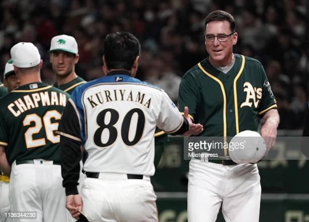 Head coach Bob Melvin of the Oakland Athletics and Head coach Hideki Kuriyama of the Hokkaido NipponHam Fighters shake hands prior to the game...