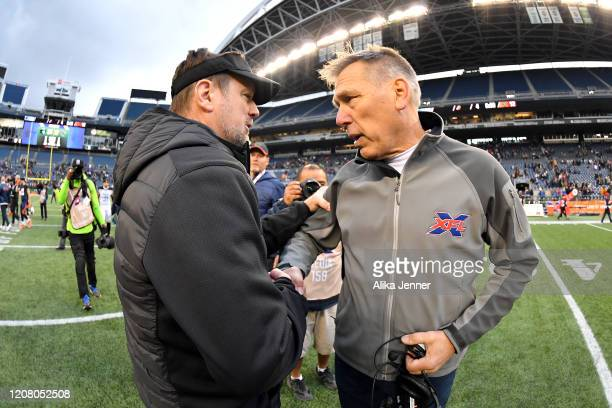 Head coach Bob Stoops of the Dallas Renegades, left, and head coach Jim Zorn of the Seattle Dragons, right, shake hands after the game at CenturyLink...
