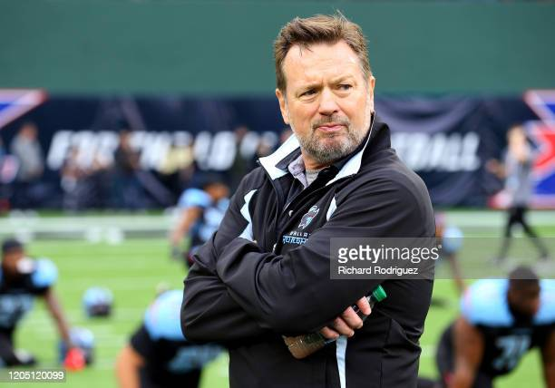 Head coach Bob Stoops of the Dallas Renegades stands on the field during warm ups before the XFL game against the St Louis Battlehawks on February 09...