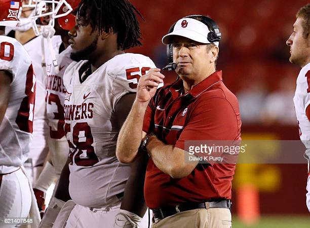 Head coach Bob Stoops of the Oklahoma Sooners coaches from the sidelines in the first half of play against the Iowa State Cyclones at Jack Trice...