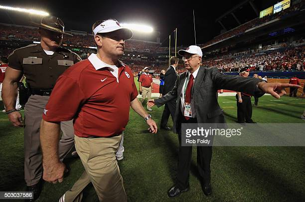 Head coach Bob Stoops of the Oklahoma Sooners walks off the field after the Clemson Tigers defeat the Oklahoma Sooners with a score of 37 to 17 to...