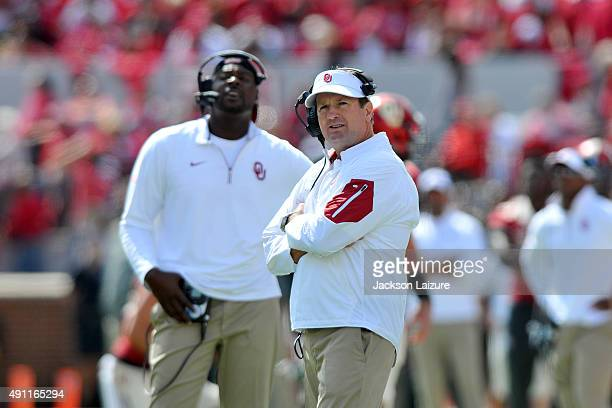 Head coach Bob Stoops of the Oklahoma Sooners watches a replay during their victory against the West Virginia Mountaineers on October 3 2015 at the...