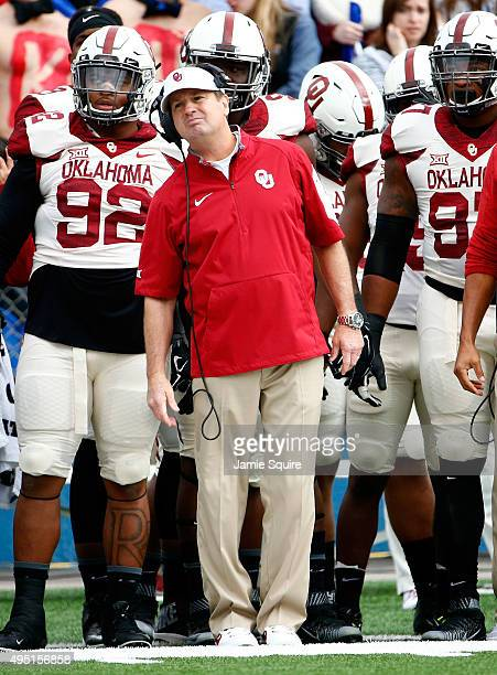 Head coach Bob Stoops of the Oklahoma Sooners watches from the sidelines during the game against the Kansas Jayhawks at Memorial Stadium on October...