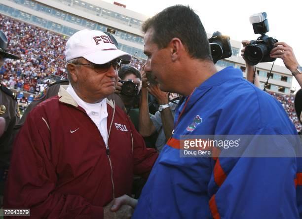 Head coach Bobby Bowden of the Florida State Seminoles congratulates head coach Urban Meyer of the Florida Gators after the Gators' victory at Doak...