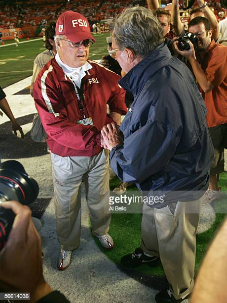 Head coach Bobby Bowden of the Florida State Seminoles wishes good luck to head coach Joe Paterno of the Penn State Nittany Lions before the Fed Ex...