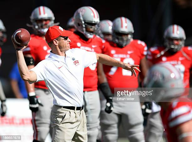 Head coach Bobby Hauck of the UNLV Rebels warms up with his players before their game against the San Jose State Spartans at Sam Boyd Stadium on...