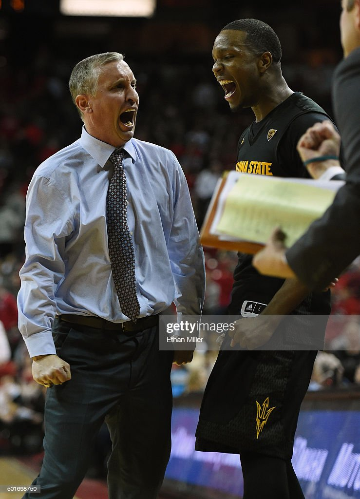 Head coach Bobby Hurley of the Arizona State Sun Devils celebrates with Willie Atwood #2 on the bench late in the team's 66-56 win over the UNLV Rebels at the Thomas & Mack Center on December 16, 2015 in Las Vegas, Nevada.