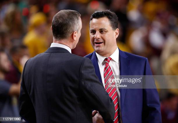 Head coach Bobby Hurley of the Arizona State Sun Devils shakes hands with head coach Sean Miller of the Arizona Wildcats before the college...