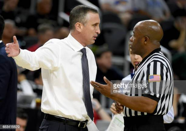 Head coach Bobby Hurley of the Arizona State Sun Devils talks with an official during a quarterfinal game of the Pac12 Basketball Tournament against...