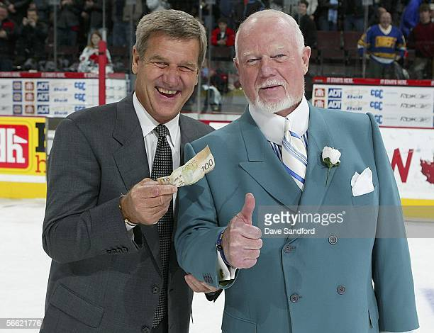 Head coach Bobby Orr of Team Orr smiles and holds up the $100 he won from head coach Don Cherry of Team Cherry after Orr's team won the CHL Top...