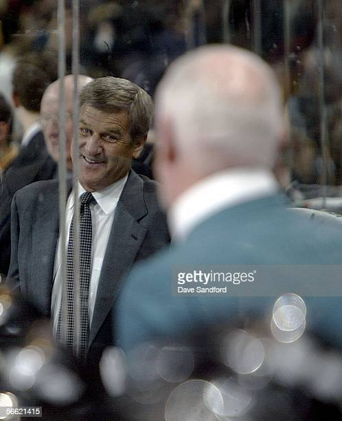 Head coach Bobby Orr of Team Orr smiles at head coach Don Cherry of Team Cherry after Orr's team took the lead during the CHL Top Prospects game at...