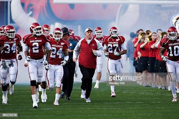 Head Coach Bobby Petrino of the Arkansas Razorbacks runs onto the field before the Spring Red White game at Donald W Reynolds Stadium on April 18...