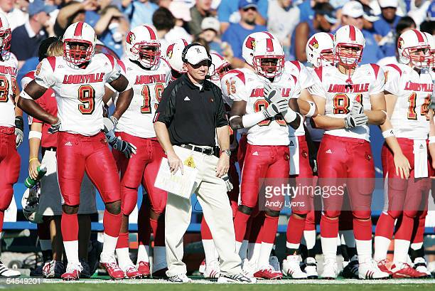 Head coach Bobby Petrino of the Louisville Cardinals looks on from the sidelines with his players during the game against the Kentucky Wildcats on...