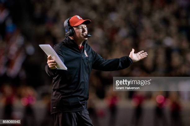 Head coach Bobby Petrino of the Louisville Cardinals reacts during the game against the North Carolina State Wolfpack at Carter Finley Stadium on...