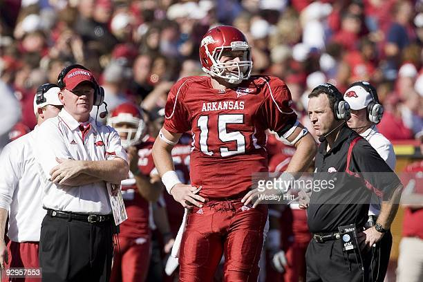 Head Coach Bobby Petrino Ryan Mallett and Assistant Coach Tim Horton of the Arkansas Razorbacks on the sidelines during a game against the South...