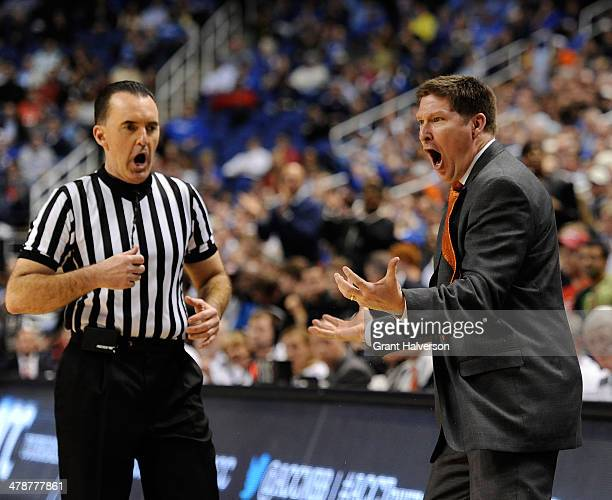 Head coach Brad Brownell of the Clemson Tigers argues a call with official Roger Ayers during a loss to the Duke Blue Devils during the quarterfinals...