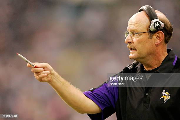 Head coach Brad Childress uses his Sharpie to make a point with quarterback John David Booty of the Minnesota Vikings in a preseason game against the...