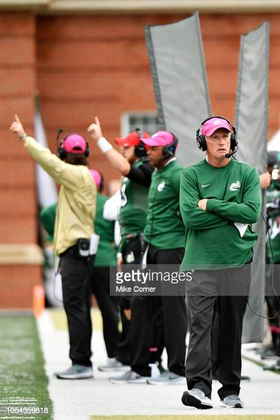Head coach Brad Lambert of the Charlotte 49ers walks the sidelines during the 49ers' football game against the Southern Miss Golden Eagles at Jerry...
