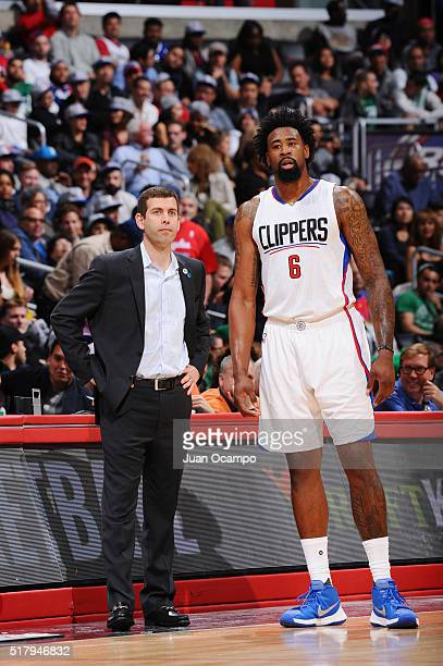 Head coach Brad Stevens of the Boston Celtics and DeAndre Jordan of the Los Angeles Clippers talk during the game on March 28 2016 at STAPLES Center...