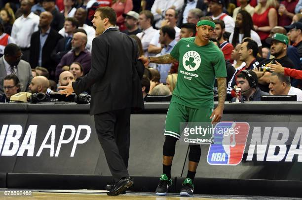 Head coach Brad Stevens of the Boston Celtics is held back by Isaiah Thomas in the fourth quarter against the Washington Wizards in Game Three of the...