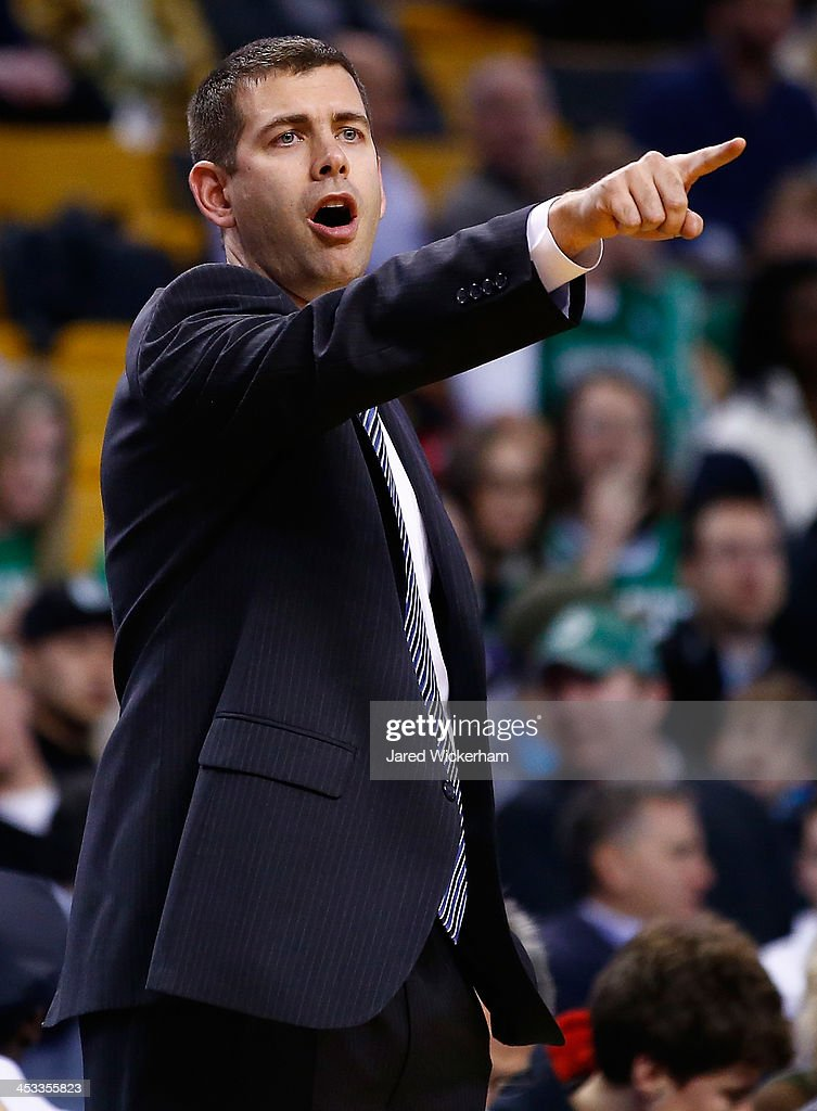 Head coach Brad Stevens of the Boston Celtics signals to his team in the first quarter against the Milwaukee Bucks during the game at TD Garden on December 3, 2013 in Boston, Massachusetts.