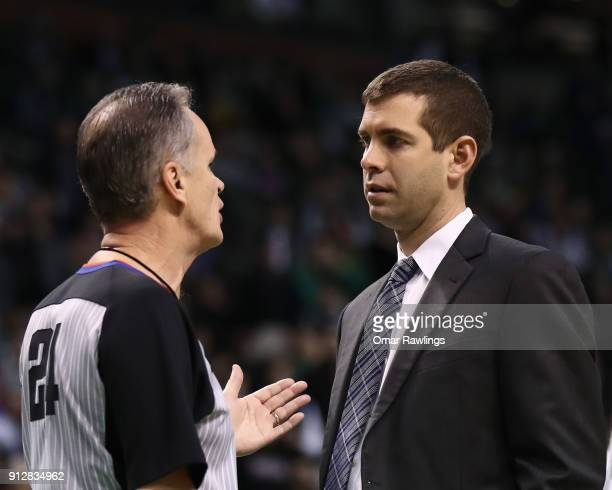 Head coach Brad Stevens of the Boston Celtics talks with Official Mike Callahan during the third quarter of the game against the New York Knicks at...