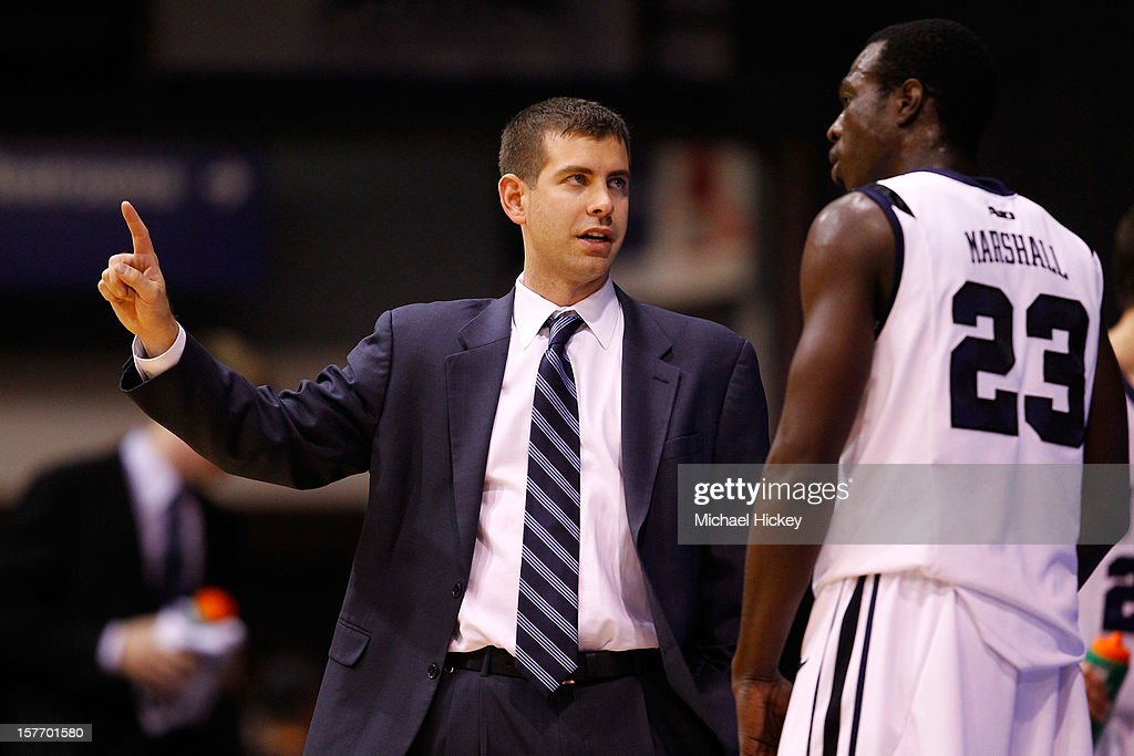 Head coach Brad Stevens of the Butler Bulldogs talks to Khyle Marshall #23 of the Butler Bulldogs on the sidelines against the IUPUI Jaguars at Hinkle Fieldhouse on December 5, 2012 in Indianapolis, Indiana. Butler defeated IUPUI