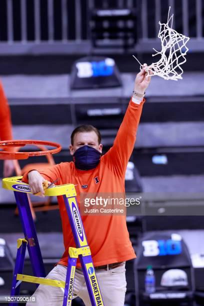 Head coach Brad Underwood of the Illinois Fighting Illini cuts down the net to celebrate winning the Big Ten Basketball Tournament championship at...