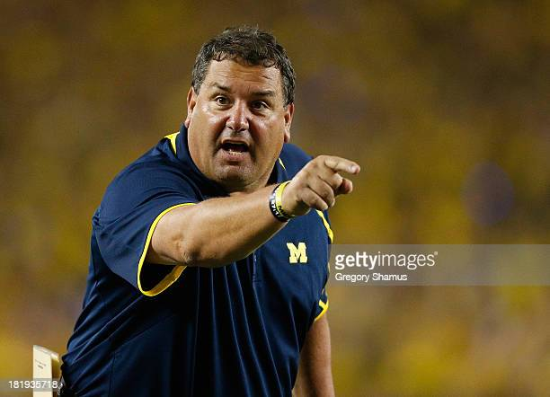 Head coach Brady Hoke argues a call with a official during the fourth quarter while playing the Notre Dame Fighting Irish at Michigan Stadium on...
