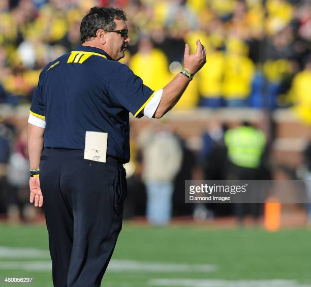 Head coach Brady Hoke of the Michigan Wolverines calls a player to the sideline during a game against the Ohio State Buckeyes at Michigan Stadium in...