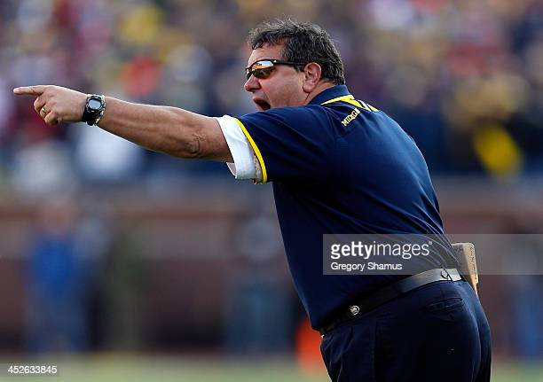 Head coach Brady Hoke of the Michigan Wolverines looks on against the Ohio State Buckeyes during a game at Michigan Stadium on November 30 2013 in...