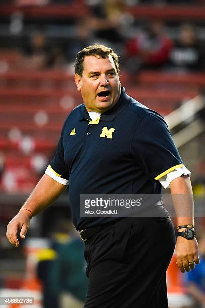 Head coach Brady Hoke of the Michigan Wolverines looks on before a game against the Rutgers Scarlet Knights at High Point Solutions Stadium on...