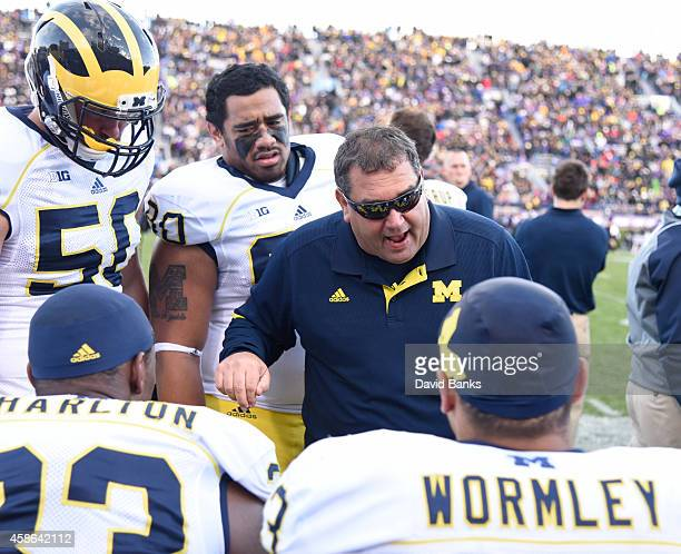 Head coach Brady Hoke of the Michigan Wolverines talks to his team during the first half of a game against the Northwestern Wildcats on November 8...