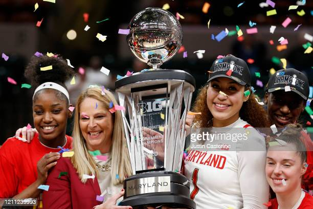 Head coach Brenda Frese and Shakira Austin of the Maryland Terrapins hold up the Big Ten Women's Basketball trophy at Bankers Life Fieldhouse on...
