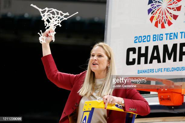 Head coach Brenda Frese of the Maryland Terrapins cuts down the nets after the Maryland Terrapins win the Big Ten Women's Championship Game over the...