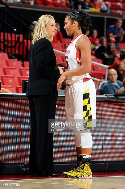 Head coach Brenda Frese of the Maryland Terrapins talks to Alyssa Thomas during the game against the Delaware State Hornets at the Comcast Center on...