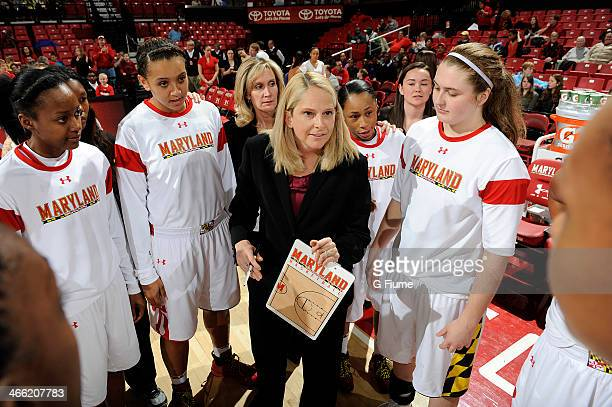 Head coach Brenda Frese of the Maryland Terrapins talks to her team before the game against the Delaware State Hornets at the Comcast Center on...
