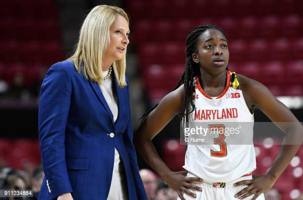 Head coach Brenda Frese of the Maryland Terrapins talks with Channise Lewis during the game against the Iowa Hawkeyes at Xfinity Center on January 4...