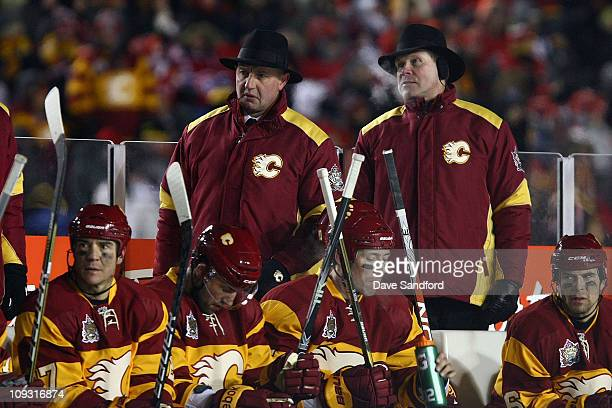Head Coach Brent Sutter and Assistant Coach Dave Lowry of the Calgary Flames look on from the bench area during the 2011 NHL Tim Hortons Heritage...
