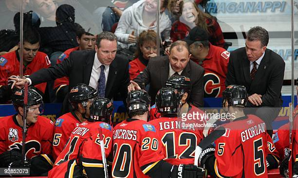 Head Coach Brent Sutter of the Calgary Flames instructs his players during a break in game action against the Colorado Avalanche on October 28 2009...