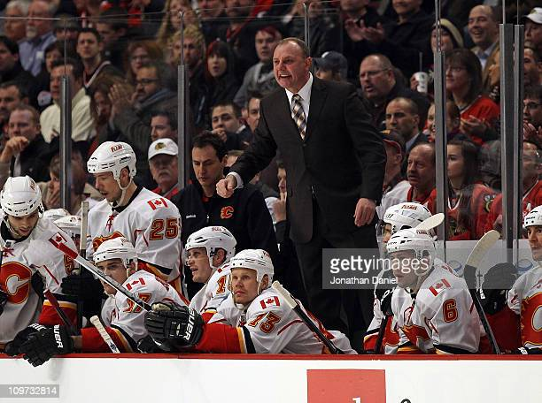 Head coach Brent Sutter of the Calgary Flames stands on the bench to yell at referees during a game against the Chicago Blackhawks at the United...