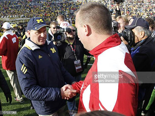 Head coach Bret Bielema of the Wisconsin Badgers shakes hands after a 48-28 win with Head coach Rich Rodriguez of the Michigan Wolverines at Michigan...