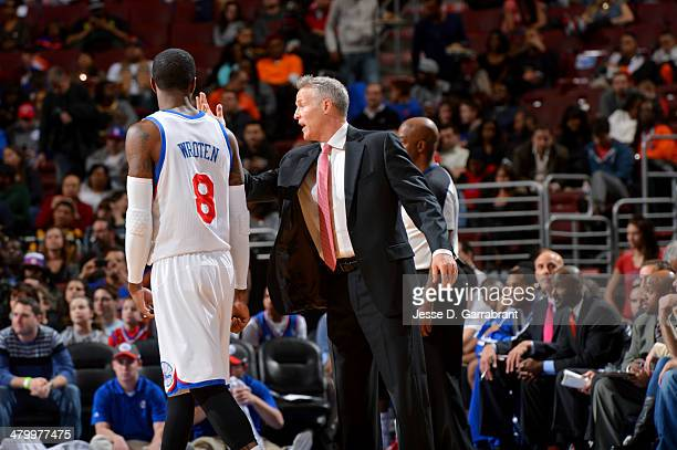 Head Coach Brett Brown and Tony Wroten of the Philadelphia 76ers talk during a game against the New York Knicks at the Wells Fargo Center on March 21...