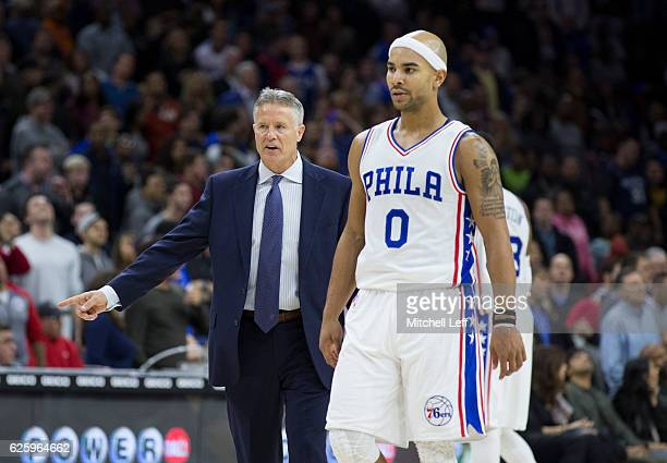 Head coach Brett Brown of the Philadelphia 76ers and Jerryd Bayless look on against the Memphis Grizzlies at Wells Fargo Center on November 23 2016...