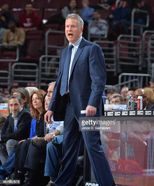 Head Coach Brett Brown of the Philadelphia 76ers gives direction to his team against the Toronto Raptors at Wells Fargo Center on March 2 2015 in...