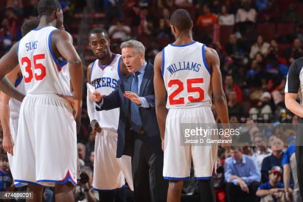 Head Coach Brett Brown of the Philadelphia 76ers gives his team direction against the Milwaukee Bucks at the Wells Fargo Center on February 24 2014...