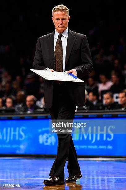 Head coach Brett Brown of the Philadelphia 76ers looks on during a game against the Brooklyn Nets at the Barclays Center on October 20 2014 in New...