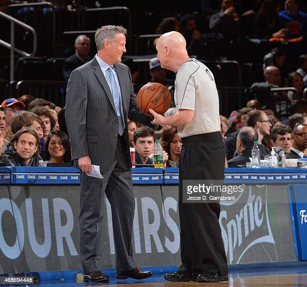 Head Coach Brett Brown of the Philadelphia 76ers shares a moment with Referee Joey Crawford against the New York Knicks at Madison Square Garden on...